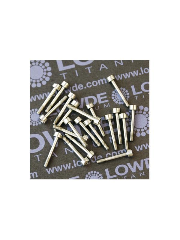 Tornillo DIN 912 M2,5x16 mm. de TITANIO gr. 5 (6Al4V) Rosca 5 mm. - Tornillo DIN 912 M2,5x16 mm. de TITANIO gr. 5 (6Al4V) Rosca 5 mm. Bisel en un lado de la cabeza. Medidas y tolerancias según plano.