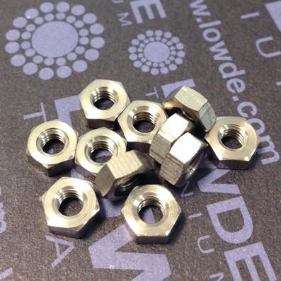 Tuerca DIN 934 M4 de titanio gr. 2 (puro) - Tuerca DIN 934 M4 de titanio gr. 2 (puro)