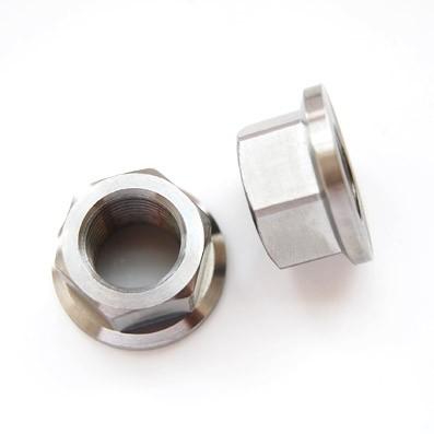 Tuerca DIN 6923 M16x1,50 de titanio gr. 5 (6Al4V). Altura tuerca: 15 mm. - Tuerca DIN 6923 M16x1,50 de titanio gr. 5 (6Al4V). Altura tuerca: 15 mm.