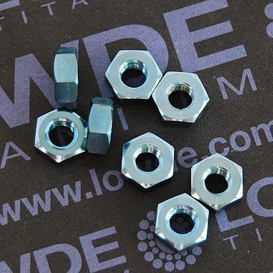 Tuerca DIN 934 M4 de titanio gr. 5 (6Al4V). Anodizada azul claro - Tuerca DIN 934 M4 de titanio gr. 5 (6Al4V). Anodizada azul claro.